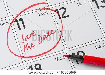 Save The Date Written On A Calendar - March 11