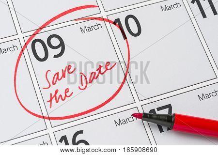 Save The Date Written On A Calendar - March 09