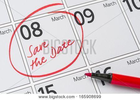 Save The Date Written On A Calendar - March 08