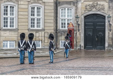 COPENHAGEN DENMARK - DECEMBER 24 2016: The changing of the guard at amalienborg palace in Copenhagen Denmark.