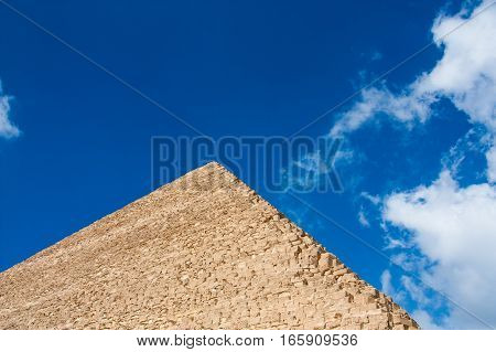 Fragment of the Great pyramids on the background of the sky