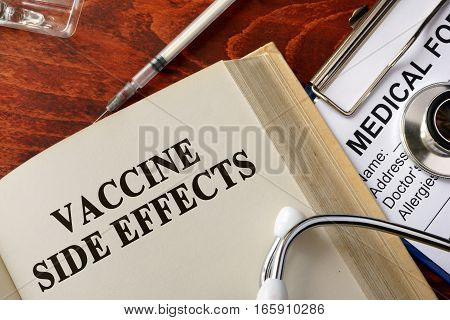 Title vaccine side effects on a book.