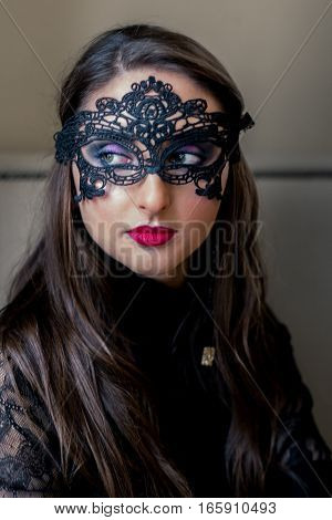 Portrait of a beautiful girl with black mask