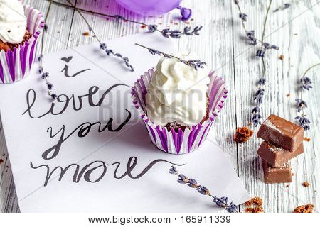 concept of Valentine's Day cupcakes on wooden background close up