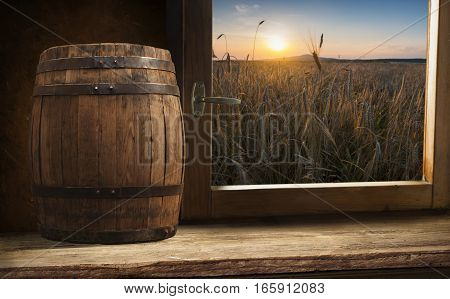 background barrel and worn old table of wood.