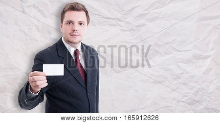 Young Businessman In Suit Showing Blank Visit Card