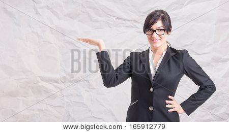 Young Smiling Businesswoman Holding Out Her Hand