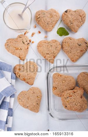 Heart shaped cookies. Biscuits with mint and pine nuts. Top view.