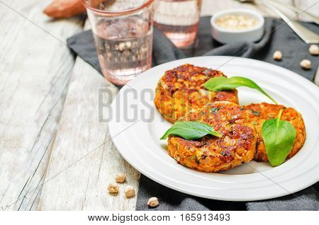 Sweet potatoes chickpea cilantro oats vegan burgers.