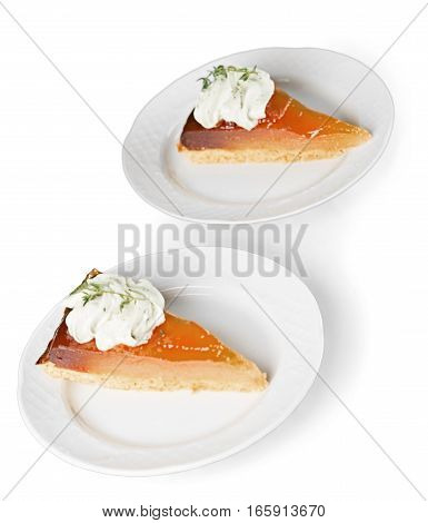 A slice of Pumpkin Cheesecake Pie with homemade whipped cream, almonds and pumpkin spice. Extreme shallow depth of field