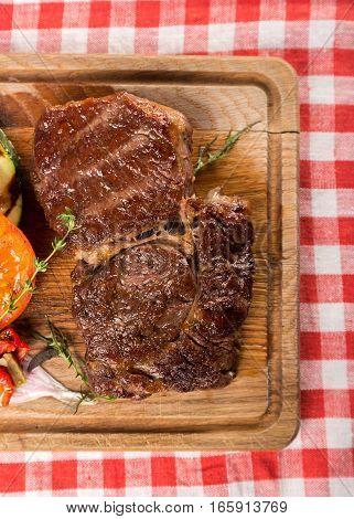 Grilled T Bone Steak on a Cutting Board