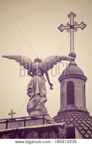 Angel Statue And Cross At Recoleta Cemetery, Buenos Aires