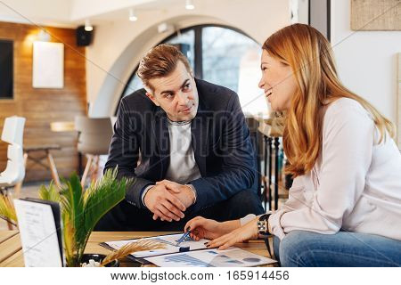 Man and woman have a business meeting in a cafe