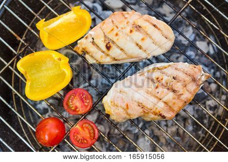 Backyard BBQ with chicken, hot dogs and burger