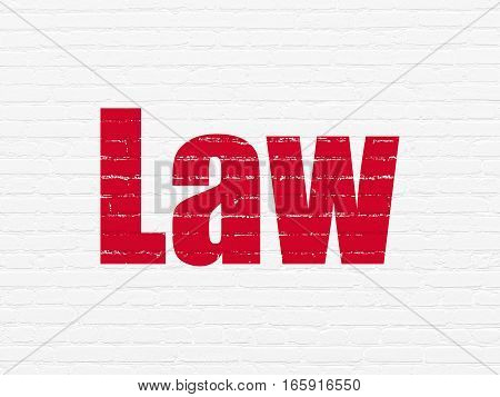 Law concept: Painted red text Law on White Brick wall background