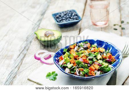 Roasted sweet potato black bean pepita avocado salad.