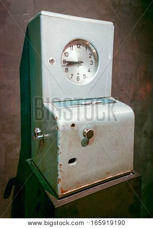 An old time clock for employees to keep track of their working hours.