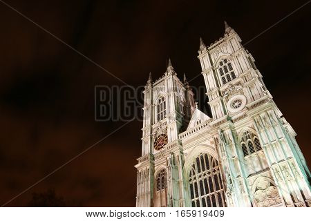 Westminster Abbey, London, UK.  Low angle night view of the façade to the iconic London landmark cathedral at Westminster.