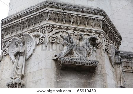 Jesus, the woman and the angels. Detail architecture Basilica of Notre-Dame de Fourviere is located on the hill of Fourviere. Lyon. France.
