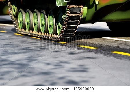 Detail shot with tank tracks and wheels during military parade