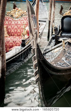 Detail of the prow of traditional gondolas from Venice Italy.