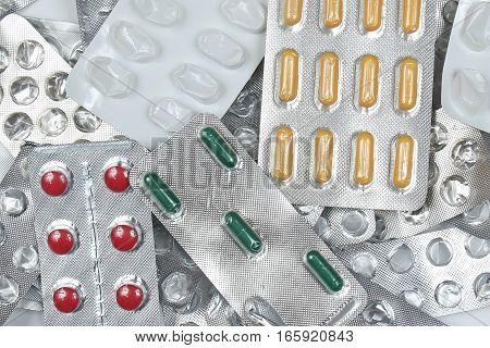 Prescription medicine pills pile in silver blisters