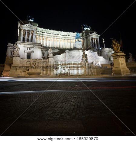 A low-angle night view of the popular Rome landmark The Monumento Nazionale a Vittorio Emanuele II (The Altare della Patria).