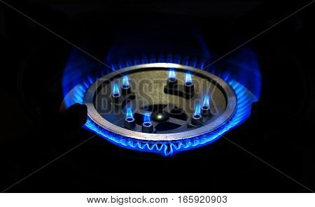 Burning natural gas on gas burner on dark background