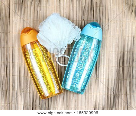 Sparkling shower gel containers with bath sponge