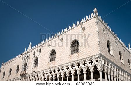 A low corner view of the Doge's Palace a popular Venetian tourist attraction found in St. Mark's square.
