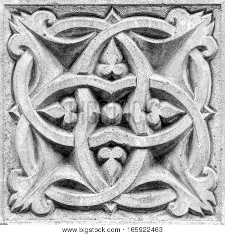 abstract ornament a stone bas-relief on the wall