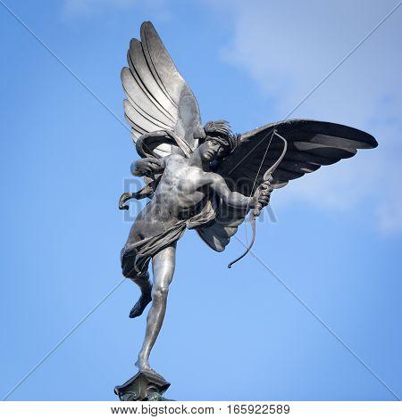 A low angle view of the familiar statue of Eros in Piccadilly Circus London.