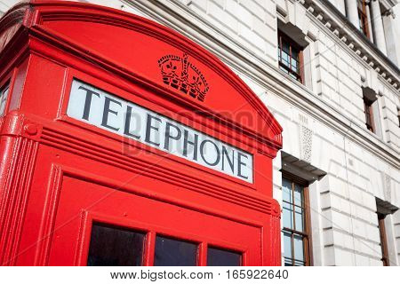 Detail of an iconic red British telephone box.