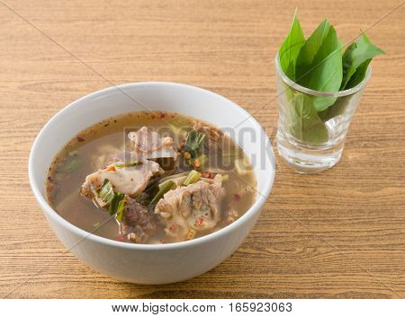 Thai Cuisine and Food A Bowl of Thai Clear Spicy Hot and Sour Soup with Beef Entrails.