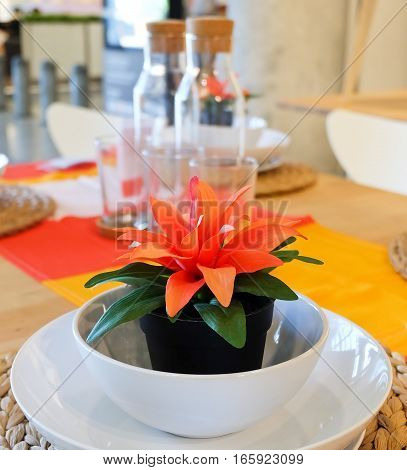 Beautiful Artificial Plant with Orange Blossom in Flowerpot for Home and Building Decoration.