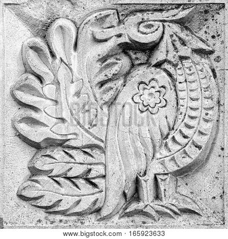 fabulous bird a stone bas-relief on the wall