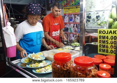 Hawker Sells Rojak On The Road Side In Penang