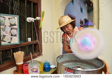 Unidentified Vendor Prepares Candy Cotton