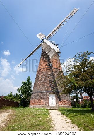 CAMBRIDGESHIRE UK - JUNE 8 2006: A traditional old English windmill which used to be a common sight on the flat Cambridgeshire Fenland.