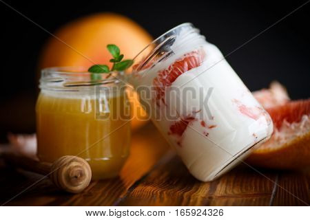 Greek yogurt with grapefruit on a black background