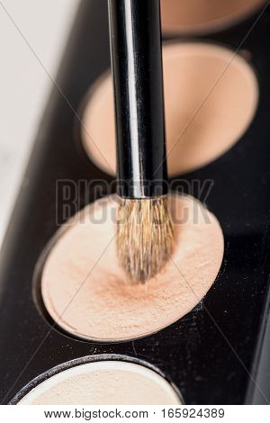 Closeup of an Eye Shadow Palette and Brush