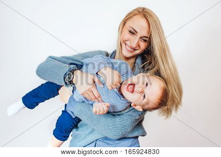 Mom holding the baby upside down, isolated