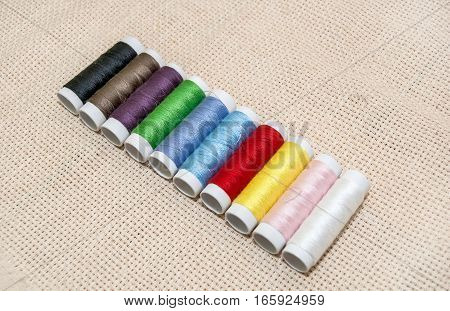 set of Sewing multicolored threads close up