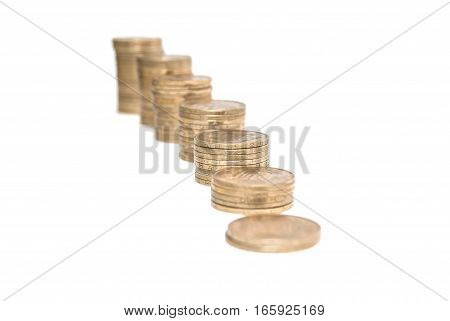 graph with Columns of golden coins isolated on white background. business and success