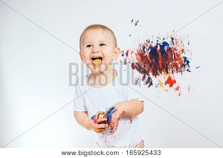 Little baby boy covered in paint for painting