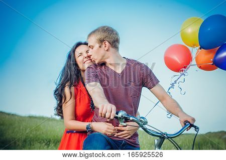 Happy Young Adult Couple In Love On The Field. Two, Man And Woman Smiling And Resting On The Green G