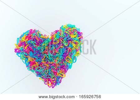Colorful heart isolated on white background made from rubber band.