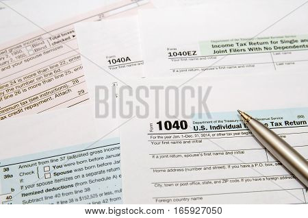 Tax Form 1040 close up with pen