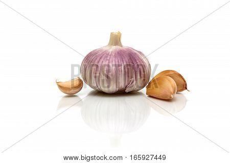 Garlic isolated on white background with reflection. horizontal photo.