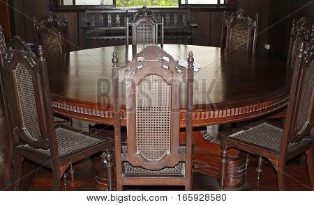 A century old dining table and chairs well preserved